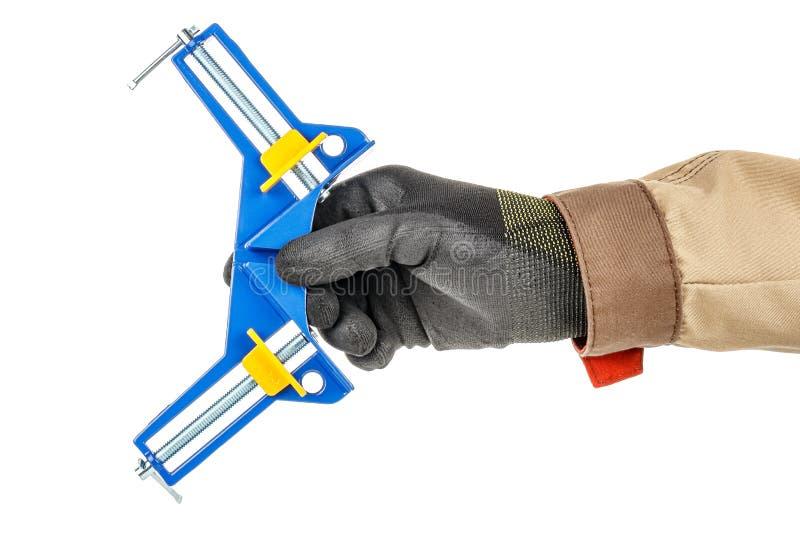 黑色防护手套男手白色背景上蓝黄夹棕色制服 库存图片