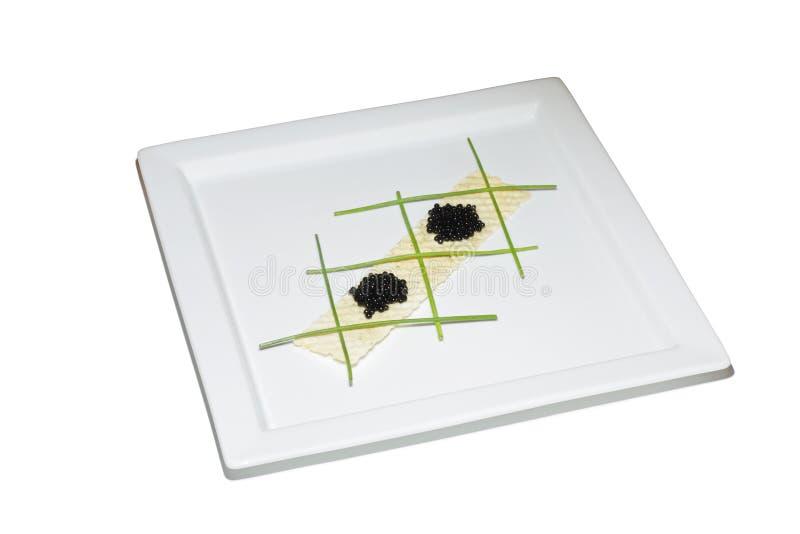 黑色鱼子酱酥脆葱土豆射击 免版税库存图片