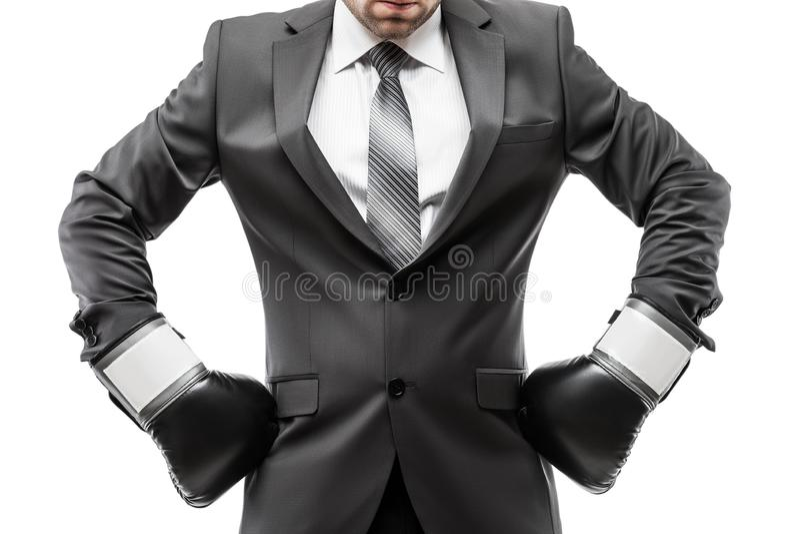 黑衣服佩带的体育拳击手套的商人拳击手 库存图片