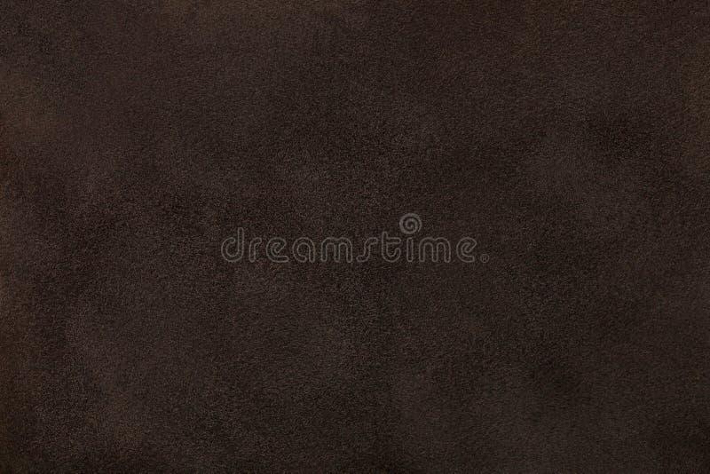 黑褐色暗淡绒面革织品特写镜头 天鹅绒纹理 库存图片
