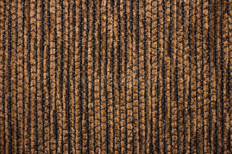 黑褐色织地不很细织品条绒纹理  免版税库存照片