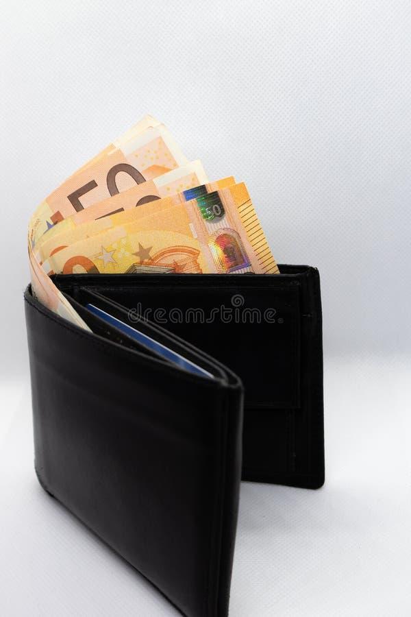 黑钱包和欧元钞票 免版税图库摄影