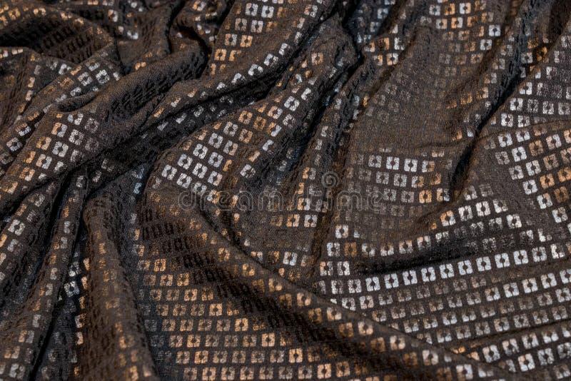 黑闪光金属片的织品 免版税库存照片