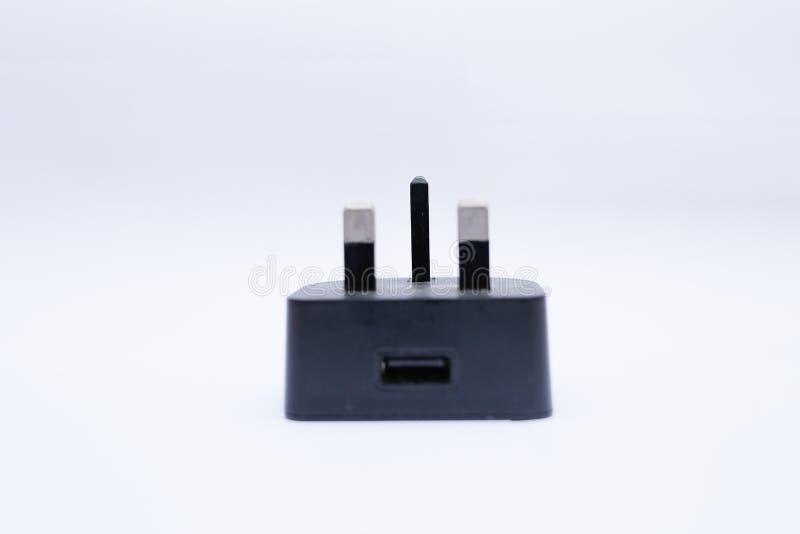 黑USB充电器头/适配器在白色背景 免版税库存图片