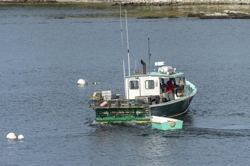 龙虾小船洛雷纳出发的Faye 免版税图库摄影