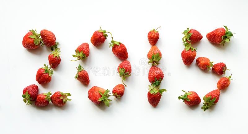 2015年,在草莓(新年的卡片)包含 免版税图库摄影