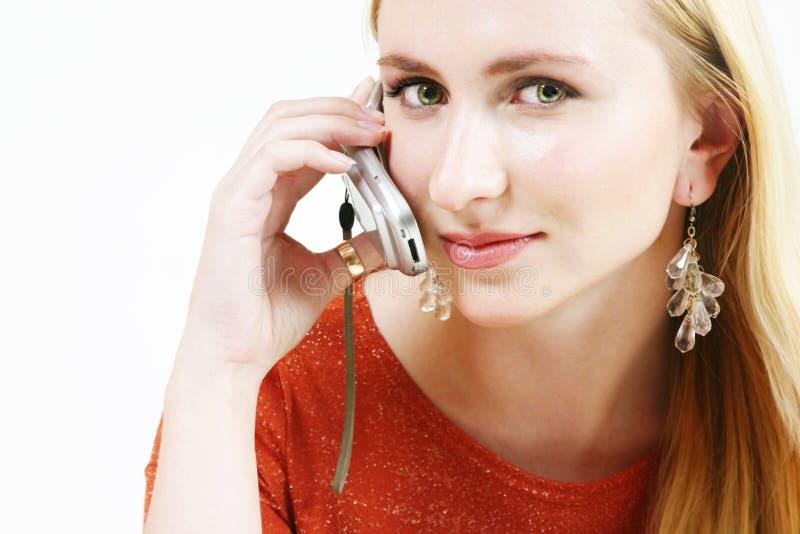 1个白肤金发的移动电话女孩 免版税库存照片