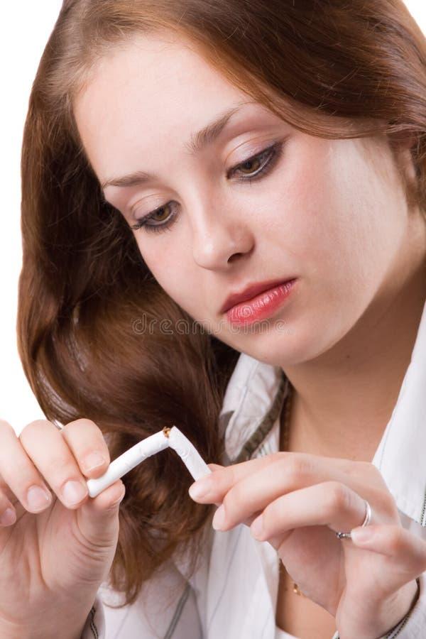 1个美丽的中断的香烟女孩 免版税库存照片