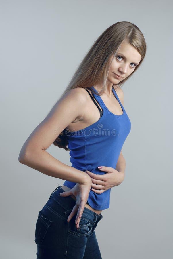 1个蓝色妇女年轻人 图库摄影