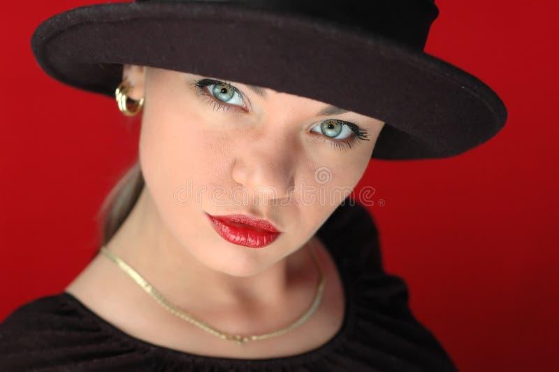 1 женщина черной шляпы стоковое изображение rf