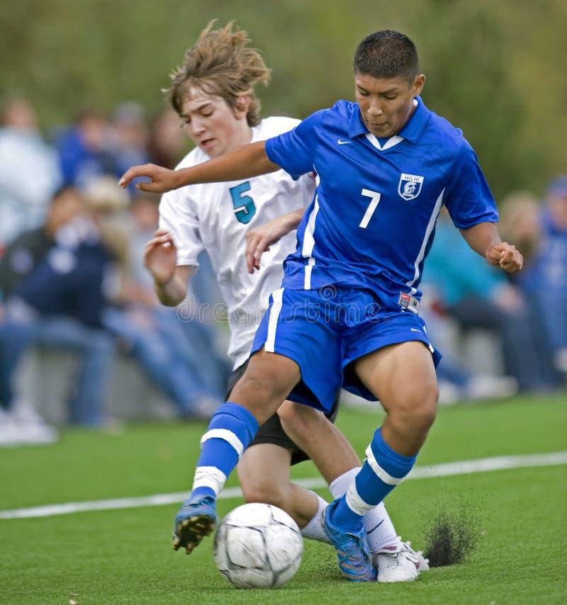 1 университетская спортивная команда футбола мальчиков стоковое фото rf