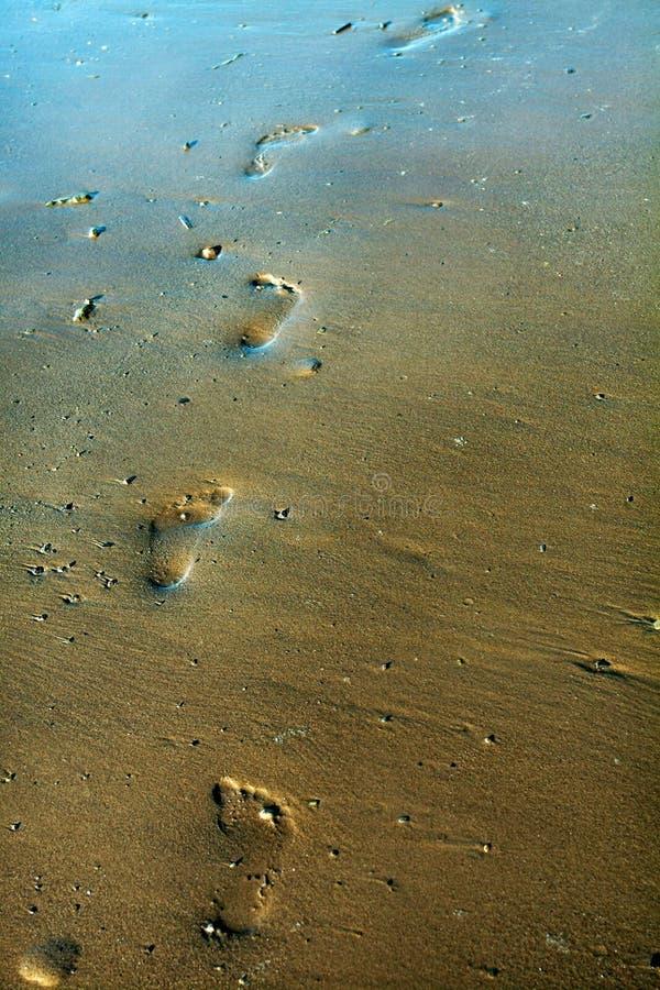 1 feetprints沙子 免版税库存照片