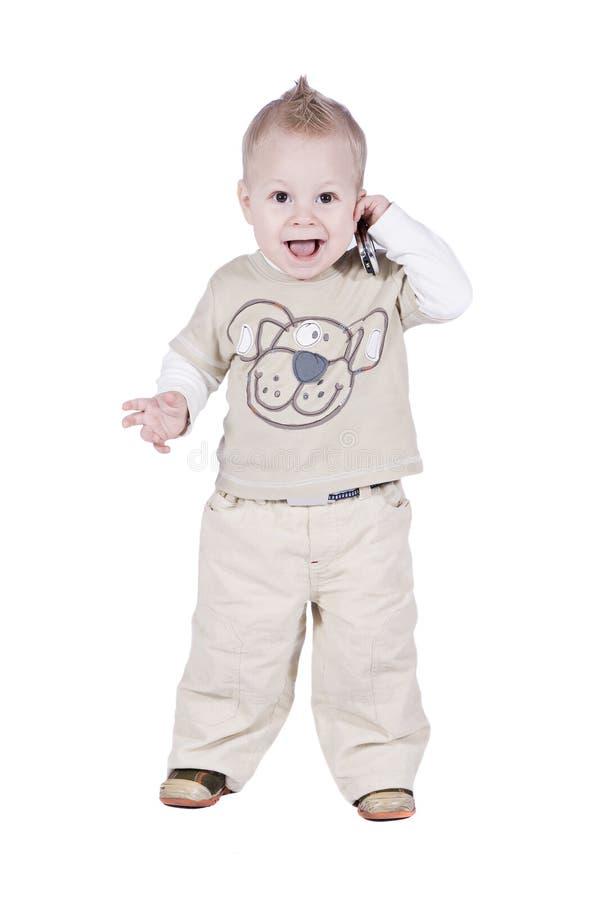 1-Jahr-Schätzchen mit Telefon lizenzfreies stockfoto
