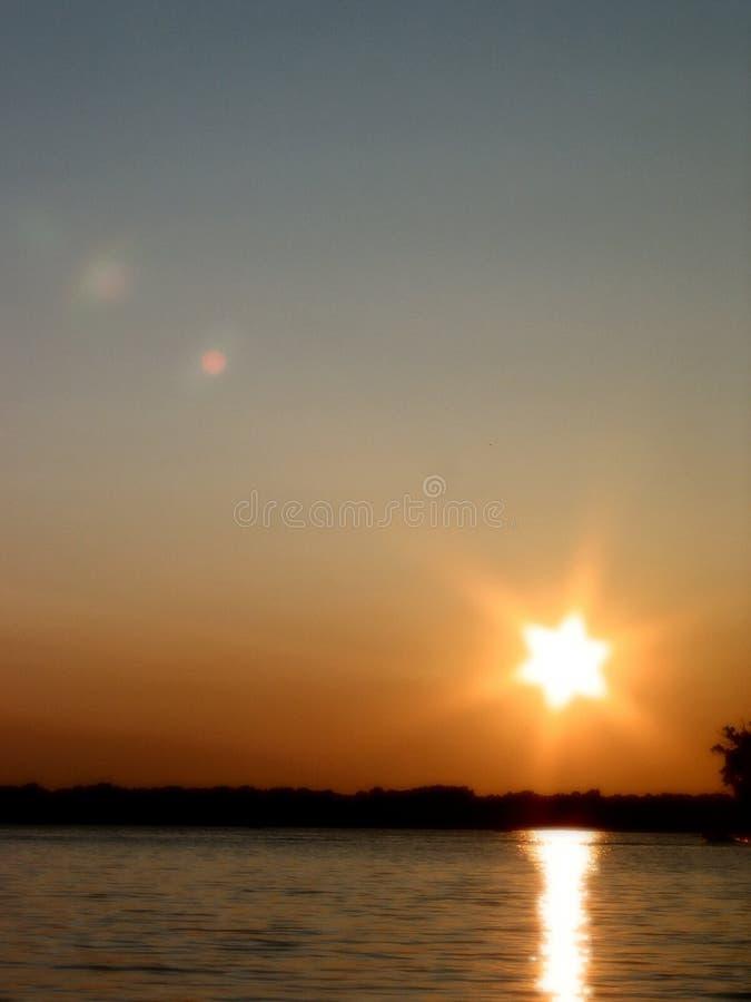 1 solnedgång för lakevass s arkivfoto