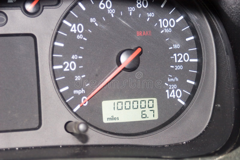 100,000 mile odometer. A digital odometer on a car dashboard shows exactly 100,000 miles royalty free stock photo