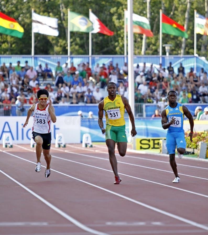 100 Bahamas Jamaica Korea mężczyzna metres obraz stock