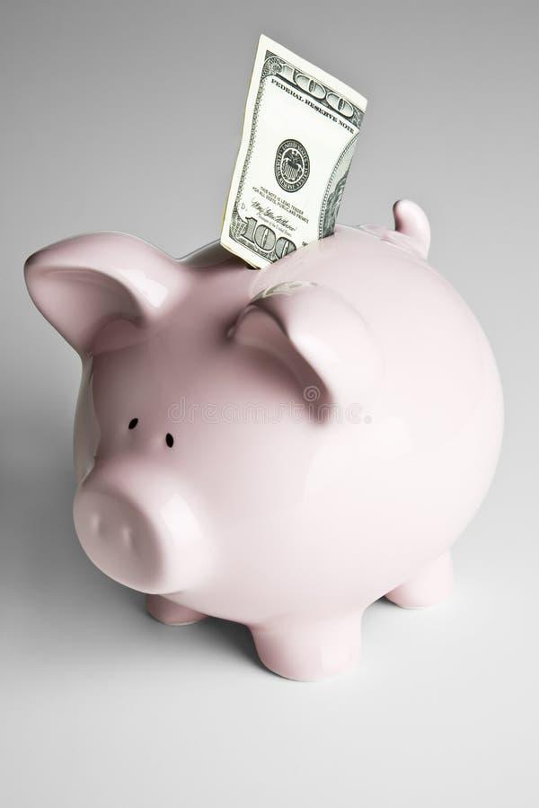 100 dollar bill and piggy bank