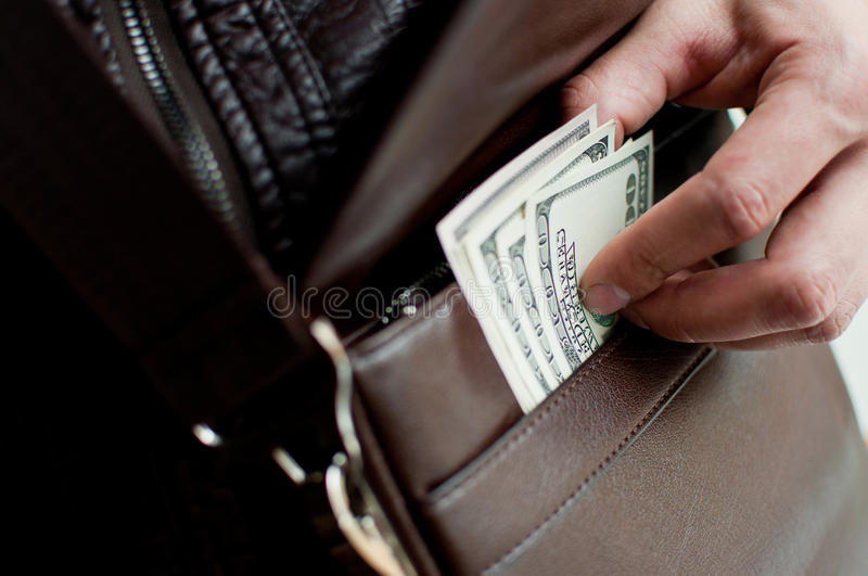 Download 100 Dollar Bills And A Leather Bag Stock Photography - Image: 27582952