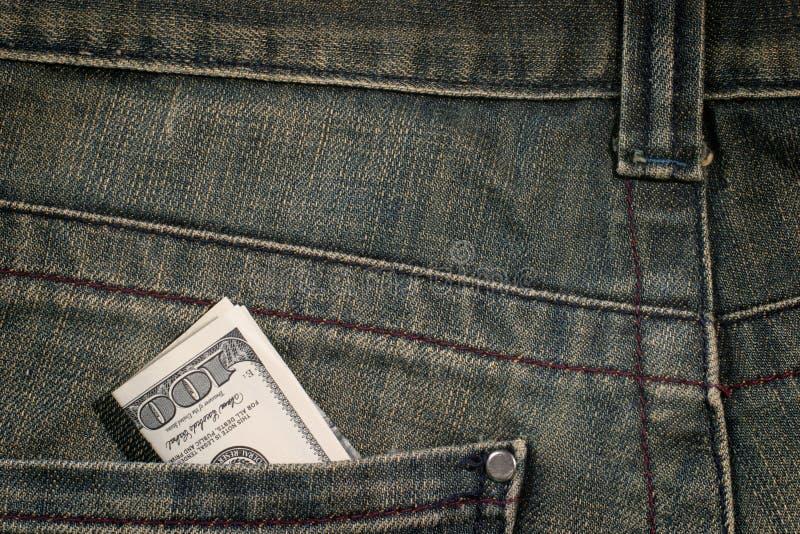 100 dollarrekening in zak stock foto