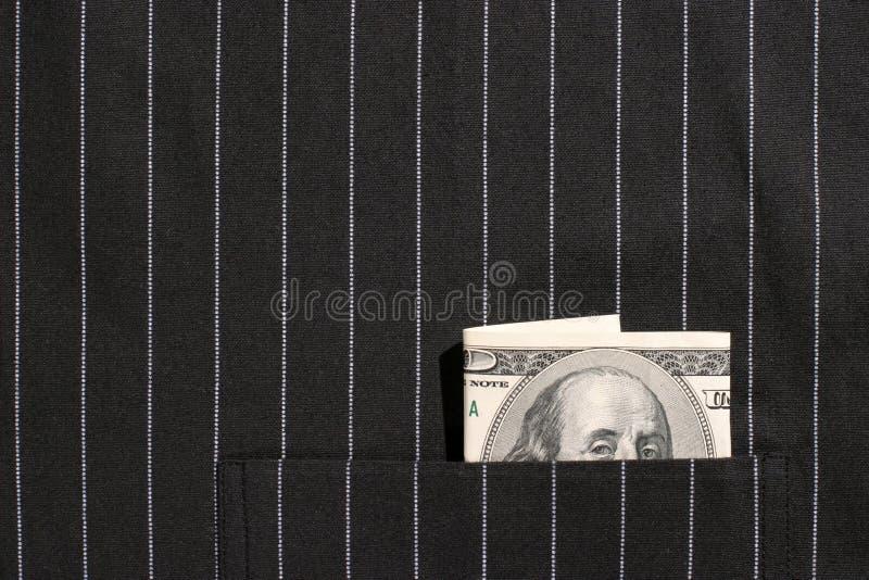 100 dollarrekening in zak stock foto's