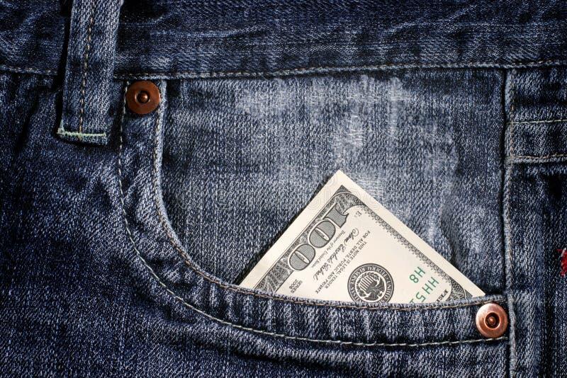 100 Dollarschein in der Tasche stockbild