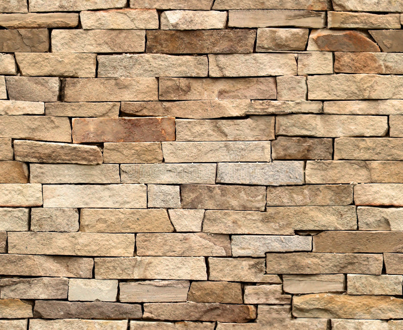 100% seamless tiling stone wall. Seamlessly tiling background texture royalty free stock photography