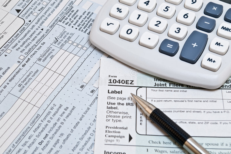 1040EZ IRS Forms. 1040EZ IRS income tax forms with pen and glasses stock images