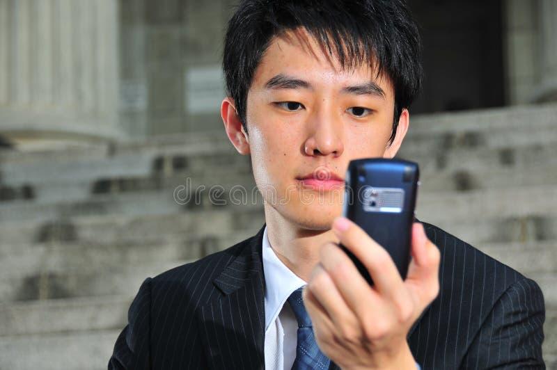 11 asian executive savvy tech 免版税库存图片