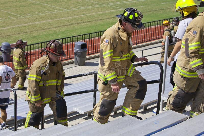 11 sep, 2011 - beklimt de HerdenkingsTrede van de Brandbestrijder stock afbeelding
