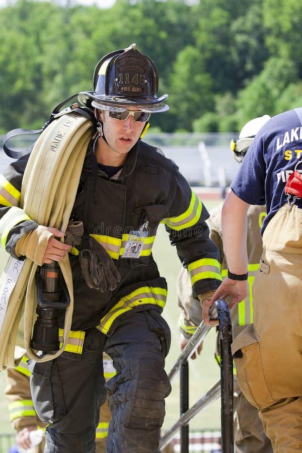 11 septembre 2011 - montée commémorative d'escalier de sapeur-pompier image libre de droits