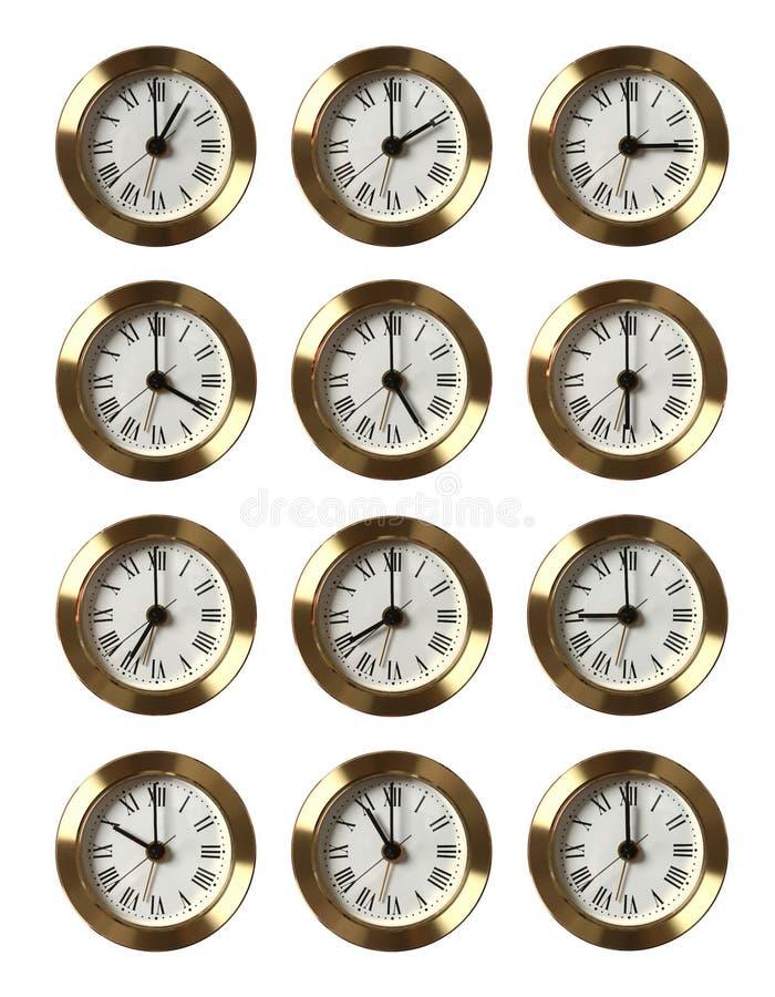 12 Borduhren, die unterschiedliche Zeit zeigen lizenzfreie stockfotos