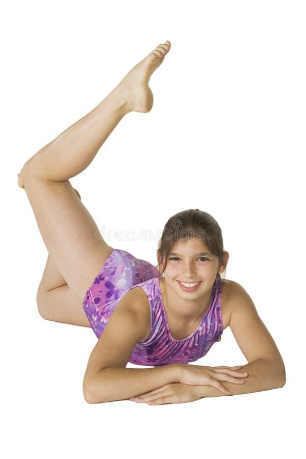 12 gammala flickagymnastik poserar år royaltyfria bilder
