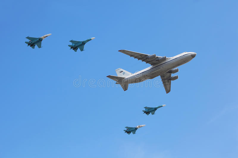 Download An-124 Plane Accompanied By Group Of Su-27 Fighter Editorial Photography - Image: 17888167