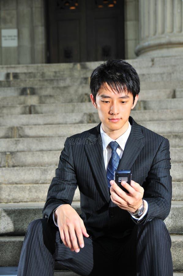 14 asian executive savvy tech 库存照片