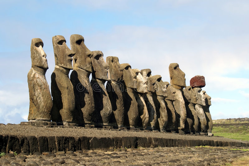 The 15 moais. Fifteen moais of different sizes from easter island royalty free stock photos