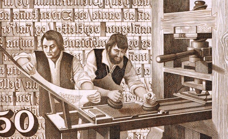 16οι εκτυπωτές αιώνα στην εργασία στοκ εικόνα