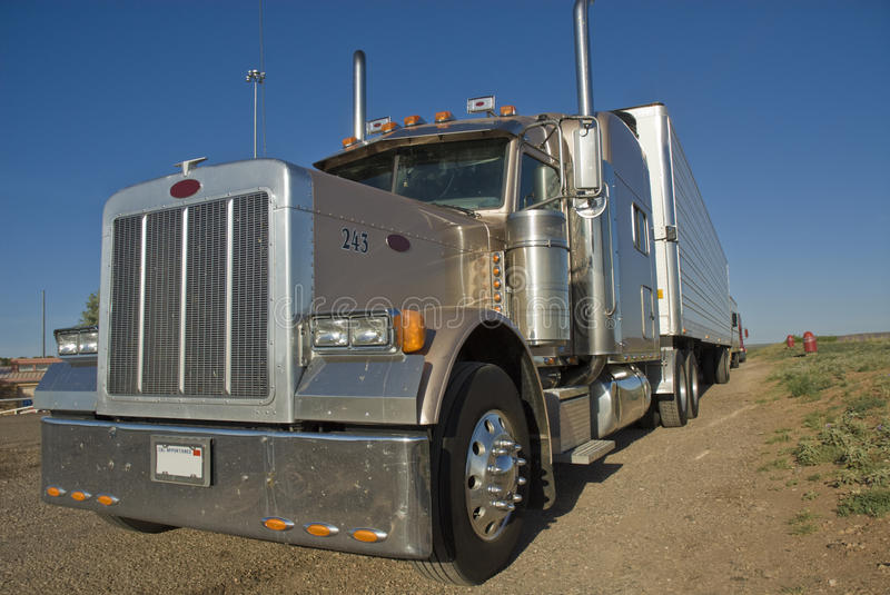 18-wheeler. 18- wheeler truck parked at a rest stop along interstate highway royalty free stock image