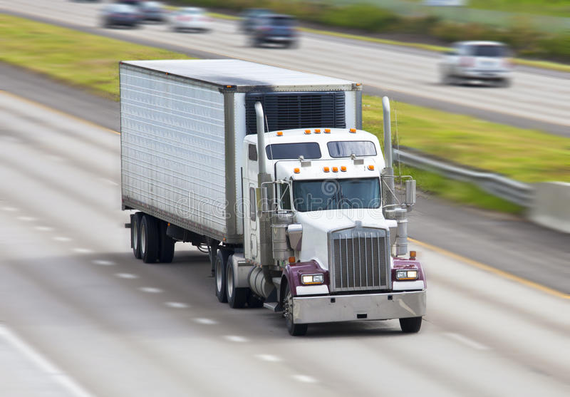 18 wheeler. Truck traveling on the highway stock photo