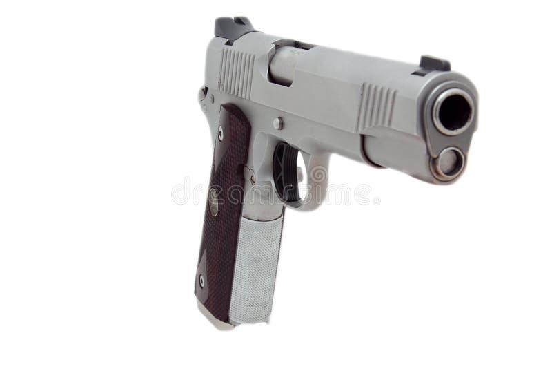1911 style semi auto pistol. A 45 caliber pistol barrel isolated on white stock photos