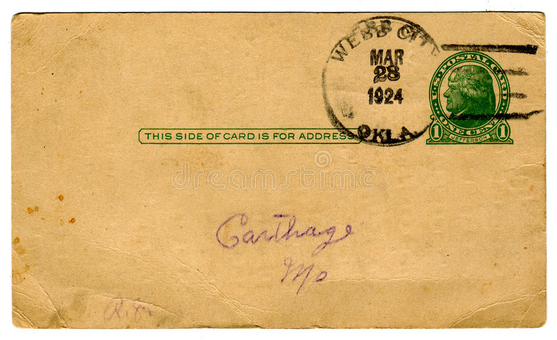 1920's Postcard, One Cent Cancel. Blank back of a 1924 souvenir postcard. Sepia tone with green text, one cent postage stamp cancelled and undivided address area royalty free stock image