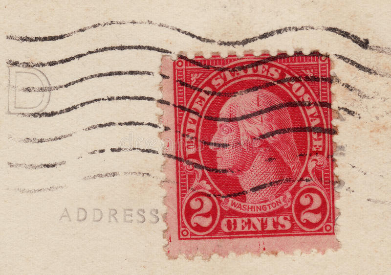 1920's Red Two 2 Cent Stamp. 1927 United States of America two cent postage stamp. Red with the image of George Washington, flag cancel royalty free stock photos