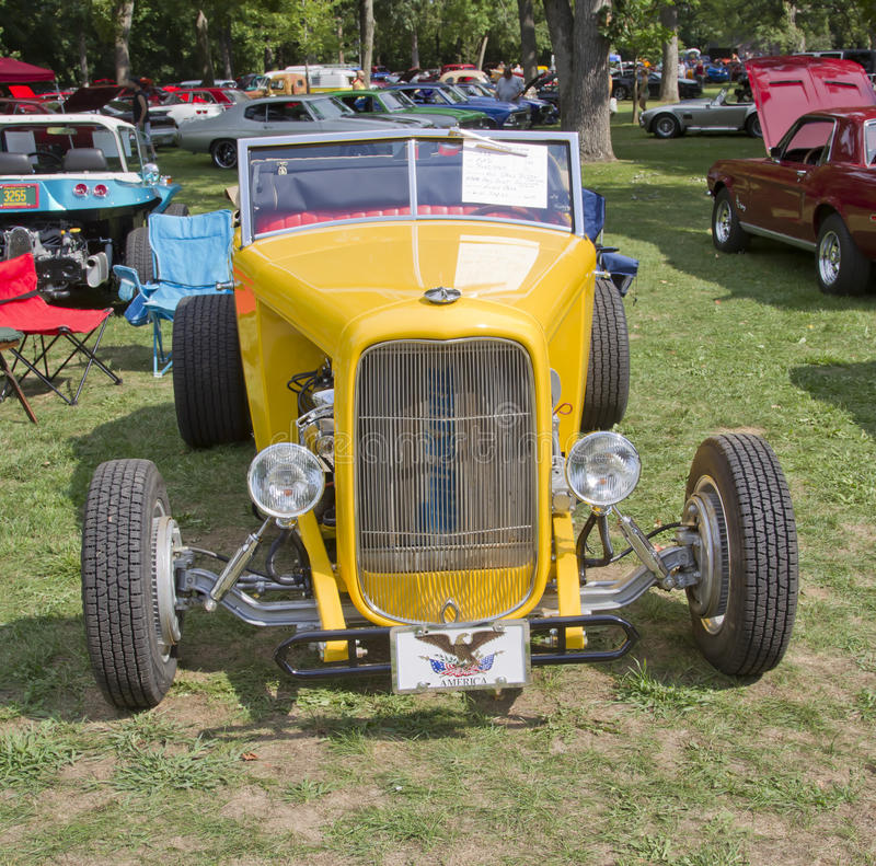 1938 Yellow Ford Roadster front view. WAUPACA, WI - AUGUST 25: Front of 1938 Yellow Ford Roadster car at the 10th Annual Waupaca Rod & Classic Car Club Car Show royalty free stock photography