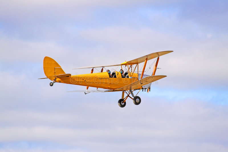 1942 Yellow DH82 Tiger Moth Bi-plane royalty free stock photos