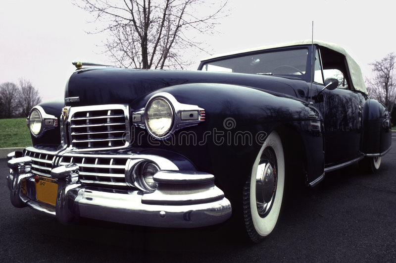 1947 Lincoln Rag-top Classic. Midnight blue antique-- rare full-frame view of a vintage convertible called the Colonel Morgan, on a moody day with reflections stock image