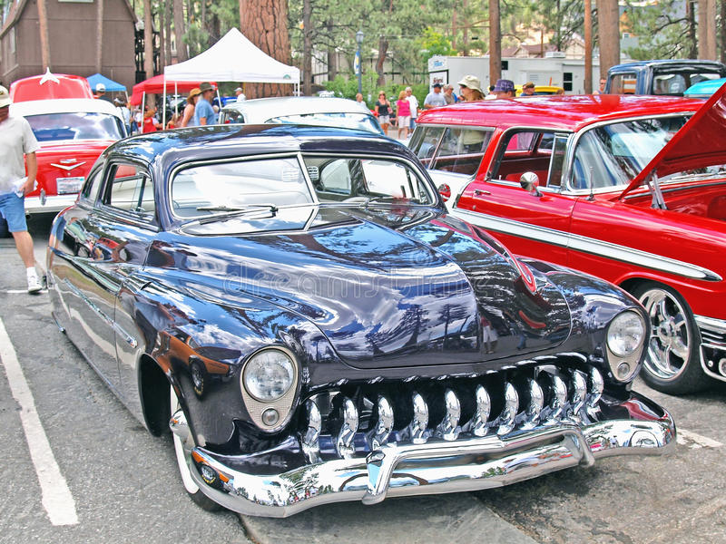 1950 Mercury. This is a black 1950 Mercury coupe with a custom hydraulic suspension enabling the driver to raise and lower the car royalty free stock photos
