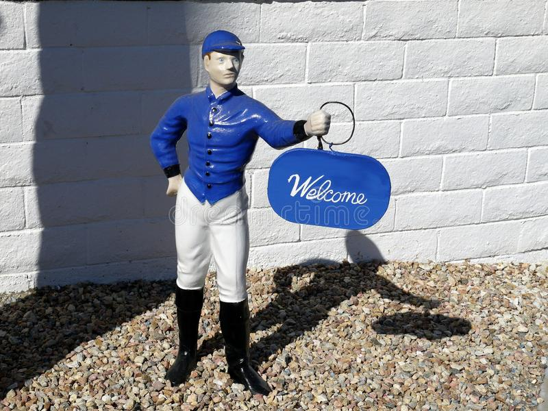 1950s: Blue lawn jockey welcome. Blue lawn jockey 1950s garden ornament, Palm Springs, California stock photography