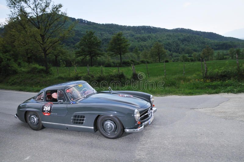 A 1955 Dark gray Mercedes 300 SL W198-I. A 1955 built Dark gray Mercedes 300 SL W198-I gullwing driven by Frank Templin and Michael Bock car during a time trial royalty free stock image