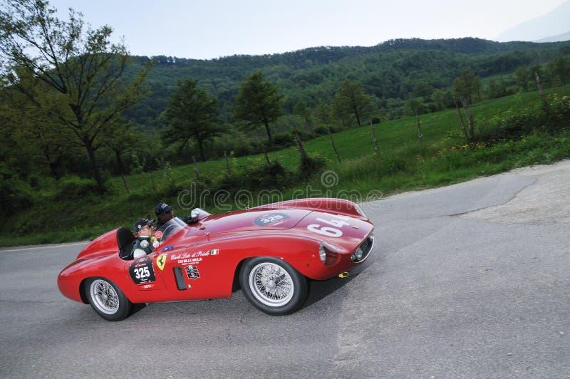 A 1955 red Ferrari 500 Mondial