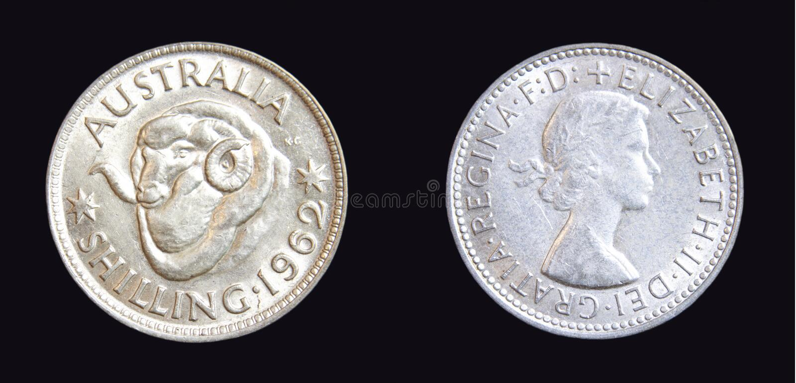 1962 Australian Shilling Silver Coin. 1962 Australian Shilling pre-decimal silver coin on isolated dark background royalty free stock photos
