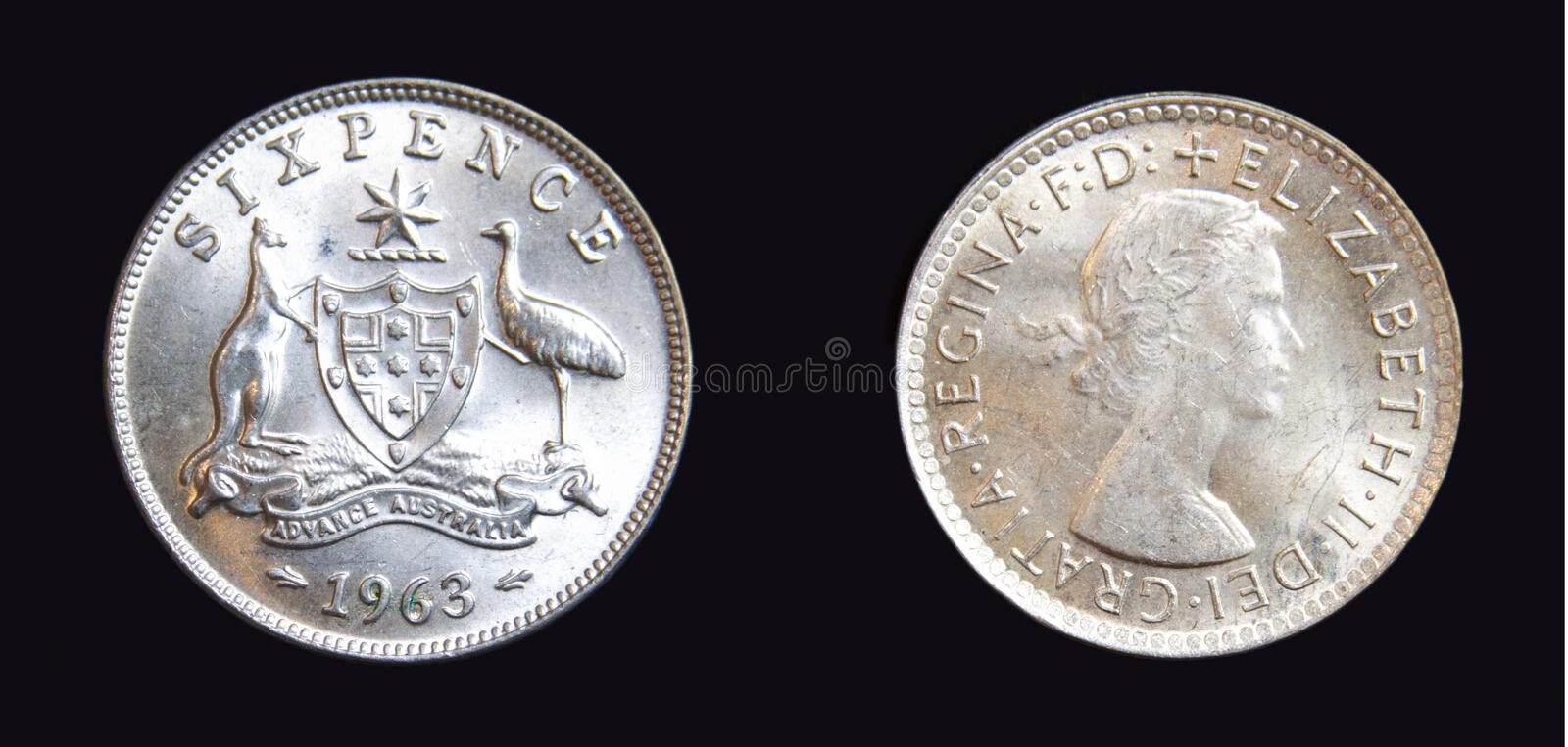 1963 Australian Sixpence Silver Coin. 1963 Australian sixpence pre-decimal 50% silver coin on isolated dark background stock photography